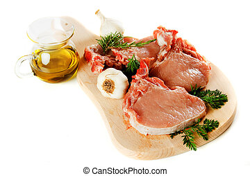 Raw pork loin chops isolated on white - Raw pork loin chops ...