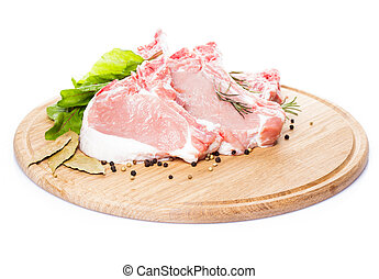 Raw loin slices on the board isolated on white