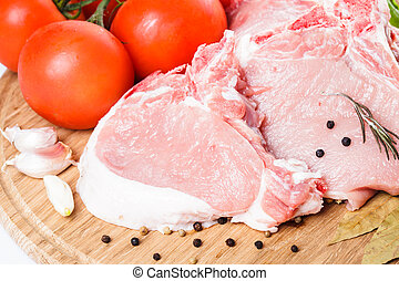 Raw pork loin - Raw loin slices on the board isolated on ...