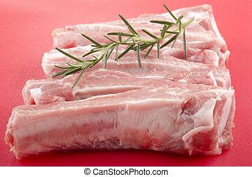 raw pork ribs and rosemary