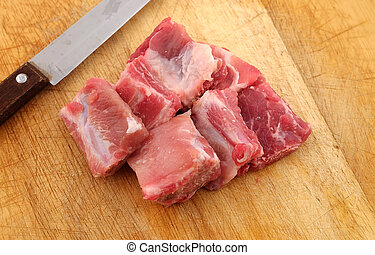 Raw pork ribs on a cutting board - close up