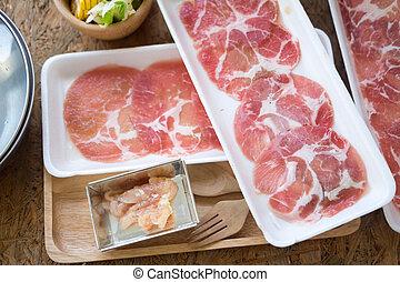 Raw pork slice on plate for hot pot