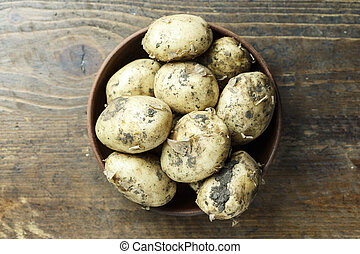 raw potatoes in a plate