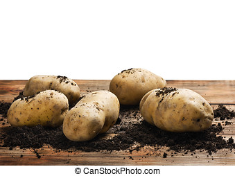 raw potatoes on the ground