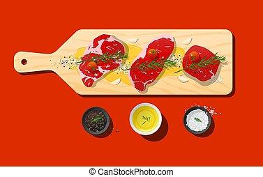 Raw prime beef steaks, rib eye, strip loin, tenderloin and seasoning on wooden cutting board
