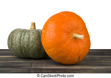 raw pumpkin on wooden table isolated on white background