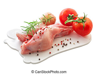Raw rabbit meat with vegetables