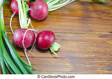 Raw radishes on a wooden table