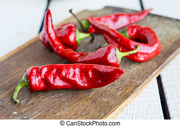 raw red chili pepper on a cutting board, spices