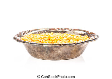 Raw red lentils isolated on white