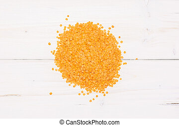 Raw red lentils on grey wood