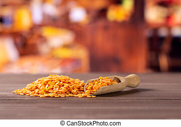 Raw red lentils with rustic kitchen