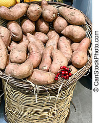 Raw Red Organic Sweet Potatoes in Sack at Supermarket.