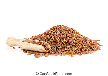 Lot of whole raw red rice heap with wooden scoop isolated on white background