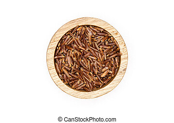 Lot of whole raw red rice with wooden bowl flatlay isolated on white background