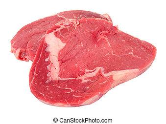 Fresh raw rib eye beef steak isolated on a white background