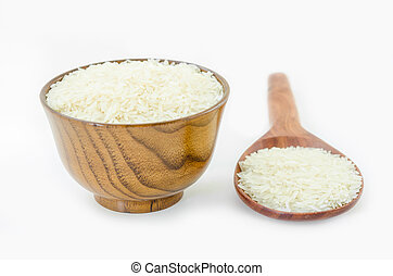Raw rice in wooden bowl and spoon.