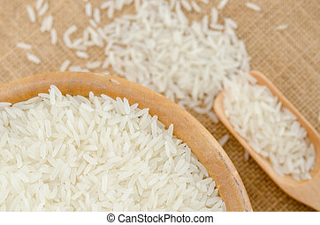 Raw rice in wooden bowl.
