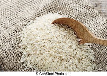 raw rice scattered on sackcloth