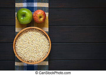 Raw Rolled Oats with Apples - Overhead shot of raw rolled ...