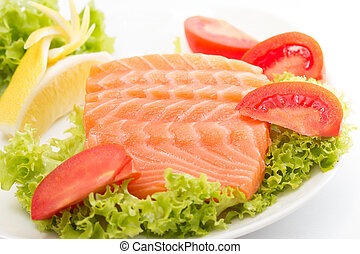 Raw salmon fillet with vegetables