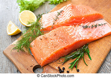 salmon fish fillet with fresh herbs - Raw salmon fish fillet...