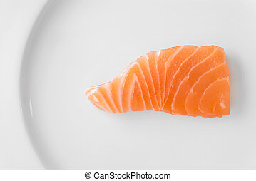salmon sliced on a white plate