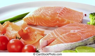 Raw salmon slices rotating - Raw salmon slices with...