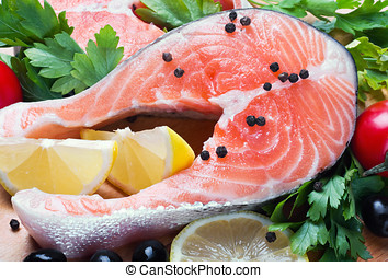 raw salmon steak with vegetables