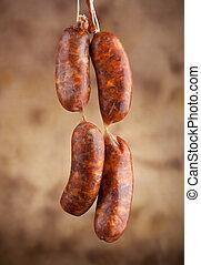 Raw sausage on beige background