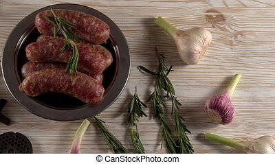 raw sausages , garlic, rosemary and old meat grinder parts