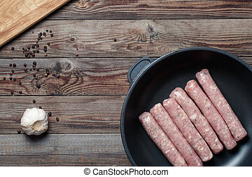 Raw Sausages in a Pan