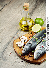 Raw seabass fish on the wooden board