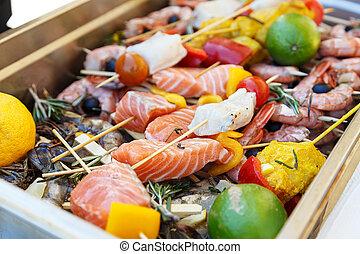 Raw seafood kebabs
