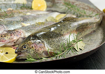 trout on a frying pan
