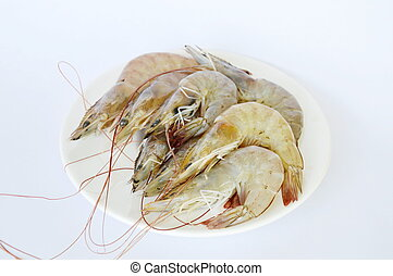 raw shrimp on dish in white background