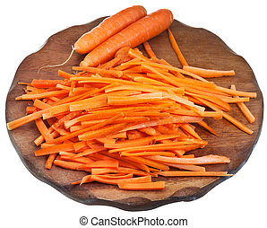 raw sliced carrot on wooden board
