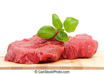 raw steak meat on cutting board