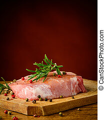 Raw steak - Raw pork steak, rosemary and pepper spices