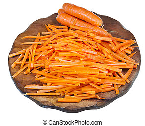 raw strips sliced carrot on cutting board