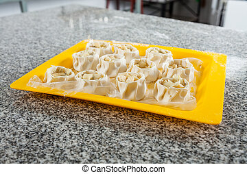 Raw Stuffed Pasta In Tray On Counter