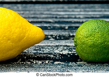 Raw textured black Background backdrop with lemon and lime and copy space