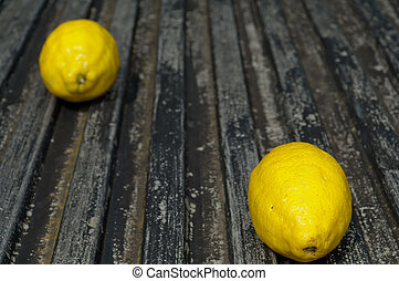 Raw textured black Background backdrop with lemon copy space