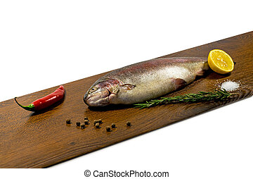 Raw trout on a wooden board