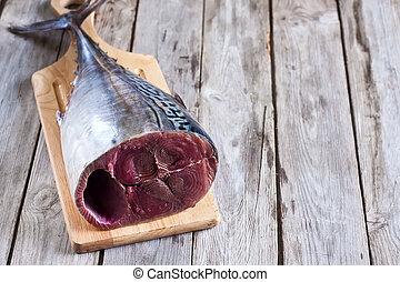 Raw tuna - Fresh raw tuna tail on wooden board. Selective...