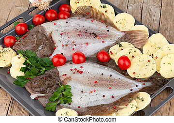 Raw Turbot Fish - Overhead shot of tray with raw turbot fish...