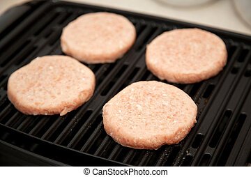 Raw Turkey Burgers on Grill