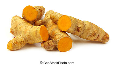 Raw turmeric over white background