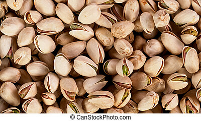 Raw unsalted pistachios nuts, top down view, macro shot.