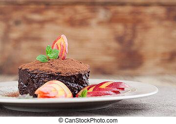 Raw vegan avocado chocolate mousse with nectarine